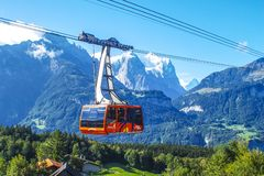 Cable car in the snow capped mountains Stock Image