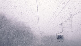 Cable car in snowfall Stock Image