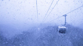 Cable car in snowfall Royalty Free Stock Image