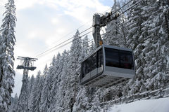 Cable car in snowy forest Stock Images