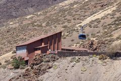 Cable car station at the foot of the Teide volcano. Blue cabin begins to climb to the top. National Park Teide, Tenerife, Canary. Islands royalty free stock images