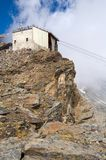 Cable car station on mountain. Cable car station on rocky mountain with cloudscape background Royalty Free Stock Photo