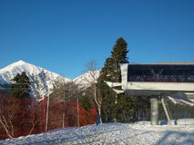 Cable car station at the winter ski resort, snow mountains. Snow capped mountains, cable car station, ski resort Krasnaya Polyana, Russia stock photography