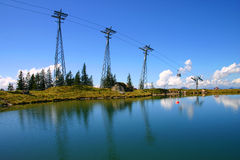 Cable car summit with blue sky and lake reflections. Fleckhalmbahn cable car summit at Kirchberg, Austria Stock Photo
