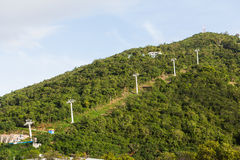 Cable Car Supports up Green Hill Royalty Free Stock Photography