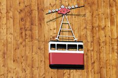 Cable car. Symbol on wooden background Stock Images