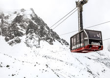 Cable Car to the Aguille du Midi peak, Mont Blanc. View of the Aguille Du Midi Cable car against the snow covered top f the French Alps, in Chamonix Mont Blanc Stock Image