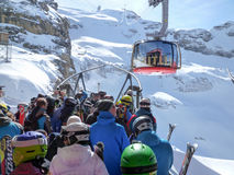 The cable car to Mount Titlis over Engelberg Royalty Free Stock Photo