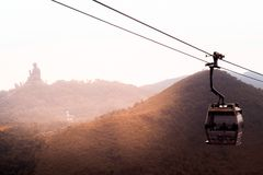 Cable car to Ngong Ping in Hong Kong in front of the Tian Tan Buddha stock photography