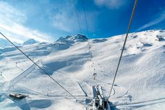 Cable car to the top of snow capped mountain with the ski track. At Zermatt the ski resort in Switzerland Stock Image
