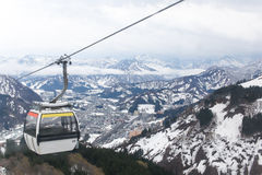 Cable car on the top of mountain cover with snow Stock Image