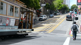 Cable car with tourists in San Francisco, USA, Stock Image