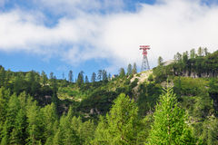 Cable car tower on hill slope Royalty Free Stock Photos