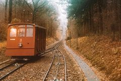 Cable car tram going through the hills to the castle of Heidelberg. Royalty Free Stock Photo