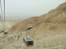 Cable car transporting tourists in Masada Fortress, Judean Desert, Israel Stock Images