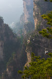Cable car in the unreal mountains in China National park. The longest cable car in the unreal mountains in China National park Stock Photos