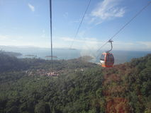 Cable car view of the forest, ocean and islands stock images