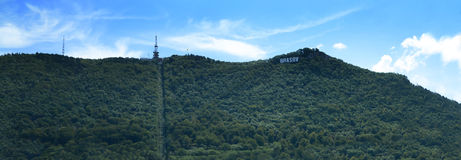 Cable car way from Tampa green Mountain forest in Brasov city. Stock Photography