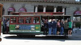 Cable Car on wheels. San Francisco, California, United States - August 17, 2016: Classic cable cars on wheels with guided tour carrying tourists in front of stock footage
