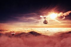 Cable car in winter mountain, inverse scenery in sunrise. Or sunset stock image