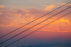 Cable car wires at sunset. The cable car wires at sunset background Royalty Free Stock Photos