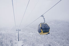 Cable car in mist  Royalty Free Stock Image