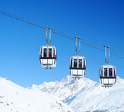 Cable cars. Three cable cars/gondolas in the snow covered Swiss Alps Royalty Free Stock Photography