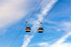 Cable cars on blue sky background in Lisbon, Portugal Royalty Free Stock Image