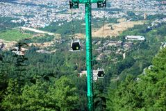 Cable cars carry people to the summit of Mount Cangshan. In Dali, Yunnan, China Royalty Free Stock Image