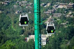 Cable cars carry people to the summit of Mount Cangshan. In Dali, Yunnan, China Stock Image
