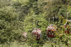 Cable cars. Carry people up to peak at qingcheng mountain , dujiangyan, China .with forest background Royalty Free Stock Images