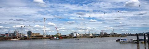 Wide angle. Cable cars crossing over River Thames, London. Cable cars crossing the River Thames between Greenwich Peninsular and The Royal Docks. The cable runs stock image
