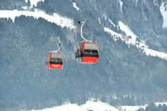 Cable cars in Eastern Alps in Kitzbuhel. Kitzbuhel Austria in December 2011. Cable cars take tourits to the ski slope royalty free stock images
