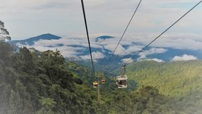 Cable cars high in the mountain. Cable cars at Genting highlands, Malaysia, travels high into the rainforest mountain Stock Images