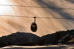 Cable cars, gondola of the Planai West in Planai. Dark mountains at the background. royalty free stock images