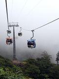 Cable Cars In The Mist. Cable cars traveling in the mist at Genting Highlands, Malaysia Stock Photos