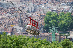 Cable cars over the city Grenoble. Royalty Free Stock Photos