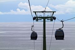 Cable cars over the sea Stock Photos