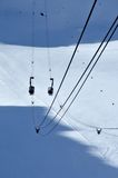 Cable cars passing over a glacier Royalty Free Stock Photo