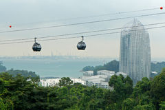 Cable cars passing by skyscraper Royalty Free Stock Photography