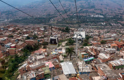 Cable cars travel over Medellin slums, Colombia Stock Photography