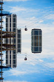 Cable cars travelling past buildings floating in the sky Royalty Free Stock Photo