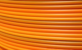 Cable conduits for fibre optics for ADSL connection for internet. Orange cable conduits for fibre optics for ADSL connection for internet users stock image