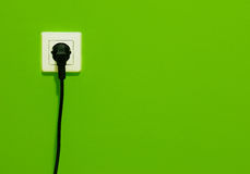 Cable in connector plug on green wall Stock Images