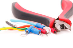 Cable connectors and metal nippers on white background Royalty Free Stock Image