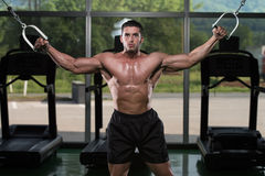 Cable Crossover Chest Workout. Bodybuilder Is Working On His Chest With Cable Crossover In Gym royalty free stock images