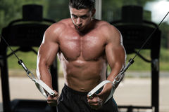 Cable Crossover Chest Workout. Bodybuilder Is Working On His Chest With Cable Crossover In Gym stock photos