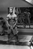 Cable Crossover Chest Workout. Young Bodybuilder Is Working On His Chest With Cable Crossover In A Dark Gym stock photos