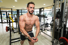 Cable Crossover Chest Workout. Young Man Bodybuilder Is Working On His Chest With Cable Crossover In A Gym royalty free stock photography