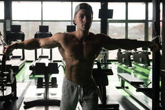 Cable Crossover Chest Workout. Young Man Bodybuilder Is Working On His Chest With Cable Crossover In A Gym royalty free stock photo